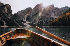 Brown Canoe in the Body of Water Near Mountain Stock Image