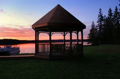 Brown Canopy Tent Near on Body of Water Stock Image