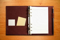 Brown canvas binder notebook with blank card Stock Photography