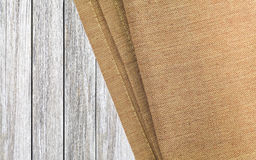 Brown canvas tablecloth on white wood Royalty Free Stock Photo