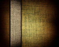 Brown canvas texture and beige strip as background Royalty Free Stock Photography