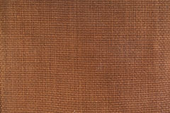 Brown canvas textured background. Stock Images