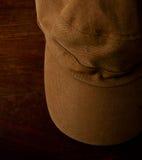 Brown cap. The brown cap on wood Stock Image