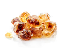 Brown caramelized sugar cubes on a white background Stock Photos