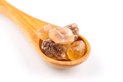 Brown caramelized sugar in a wooden spoon Stock Image