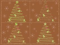 Brown card with four stylized chrismtas trees Stock Images