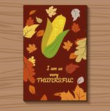 Vector card for Thanksgiving day with corn and foliage. Vector illustration. A brown Card for Thanksgiving with corn and foliage on the table. Vector Stock Photography
