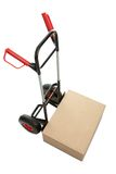 Brown cardboard box on hand truck Stock Image