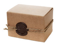 Brown cardboard box with stamp isolated on white Stock Photography