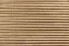Brown cardboard. Brown waved cardboard texture as background royalty free stock photos
