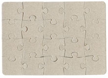 Brown cardboard jigsaw puzzle Royalty Free Stock Photo