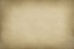 Brown cardboard of paper texture with cast framework Royalty Free Stock Image