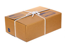 Brown cardboard postal box Royalty Free Stock Image