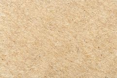 Brown cardboard sheet closeup. royalty free stock photos