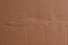 Brown cardboard sheet of paper, abstract texture. For background stock photos