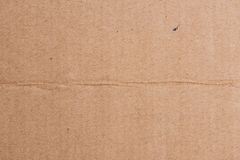 Brown cardboard sheet of paper, abstract texture. For background royalty free stock photo
