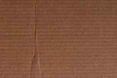 Brown cardboard sheet of paper, abstract texture. For background stock photo