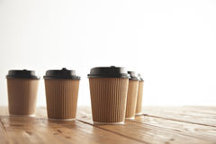 Brown cardboard take away paper cups with black caps set Stock Photos