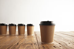 Brown cardboard take away paper cups with black caps set Royalty Free Stock Photography