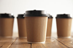 Brown cardboard take away paper cups with black caps set Stock Images