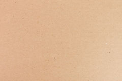 Brown cardboard texture closeup Stock Images