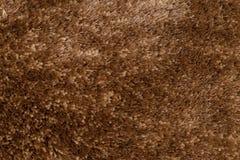 Brown carpet. Closeup detail of brown carpet texture background stock images
