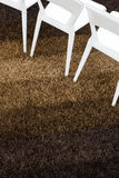 Brown carpet with part of white chairs Royalty Free Stock Photography