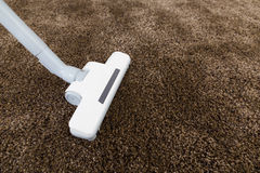 Brown carpet with vacuum cleaner Stock Image