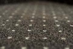 Brown carpet with a white dots texture. Indoor carpeting shoot in daylight. Brown carpet with a white dots texture. Indoor carpeting shoot in daylight stock photos