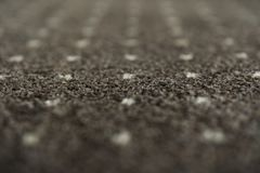Brown carpet with a white dots texture. Indoor carpeting shoot in daylight. Brown carpet with a white dots texture. Indoor carpeting shoot in daylight royalty free stock photo