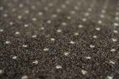 Brown carpet with a white dots texture. Indoor carpeting shoot in daylight. stock photo