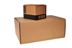 Brown carton boxes. Brown carton box on another box isolated over white background Royalty Free Stock Photos