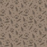 Brown cat, paw prints, fish, and hearts seamless and repeat pattern background. With texture stock photo