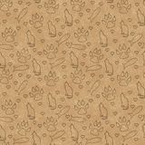Brown cat, paw prints, fish, and hearts seamless and repeat patt. Ern background with texture royalty free stock photos