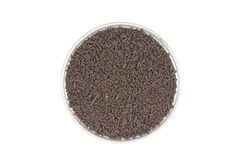 Brown catalyst pellets in a glass container Royalty Free Stock Photos