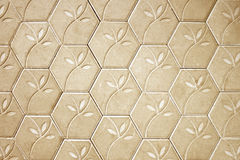 Brown cement block floor flower pattern background. Royalty Free Stock Images