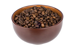 Brown ceramic bowl with coffee beans Stock Image