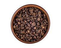 Brown ceramic bowl with coffee beans Royalty Free Stock Image