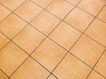 Brown ceramic floor tiles. Close up texture Stock Photo