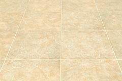 Brown ceramic floor tiles closeup texture. Background Royalty Free Stock Photography
