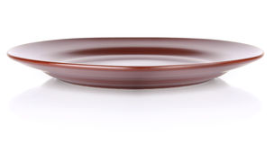 Brown ceramic plate Royalty Free Stock Photography
