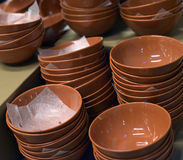Brown ceramic plates stacked Royalty Free Stock Images