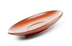 Brown ceramic saucer Stock Photography