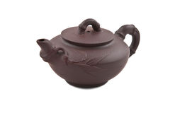 Brown ceramic teapot with bamboo ornament Stock Photo