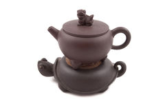 Brown ceramic teapot with cover and stand Stock Image