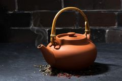 Brown ceramic teapot on a dark background Stock Photography