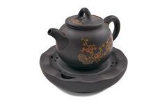 Brown ceramic teapot with golden floral ornament Royalty Free Stock Photo