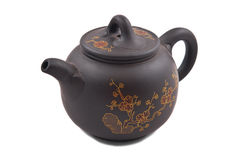 Brown ceramic teapot with golden floral ornament Royalty Free Stock Photography