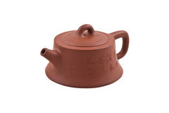 Brown ceramic teapot with hieroglyphic ornament Royalty Free Stock Photos