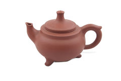 Brown ceramic teapot with legs Stock Images